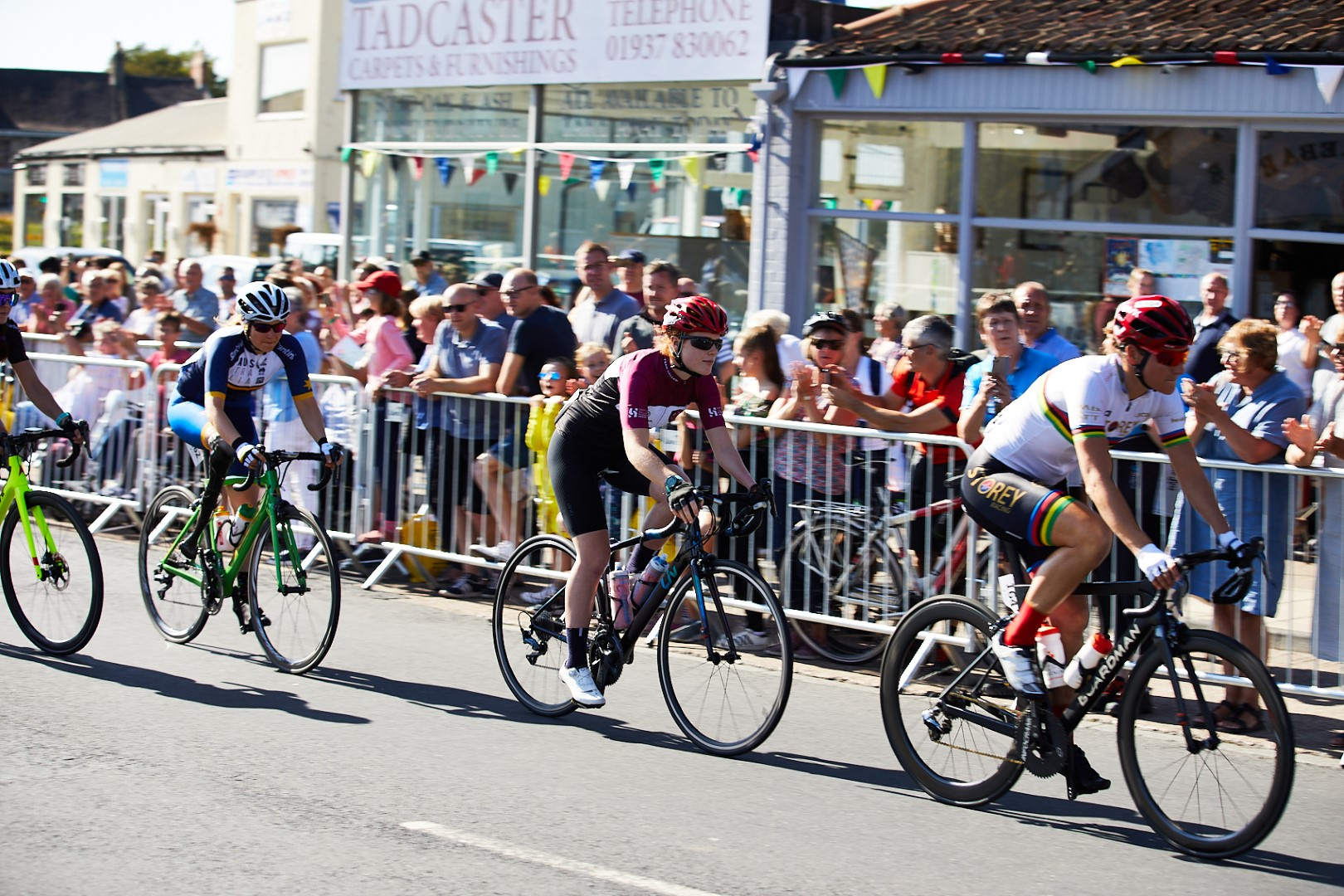 cyclists going past crowd